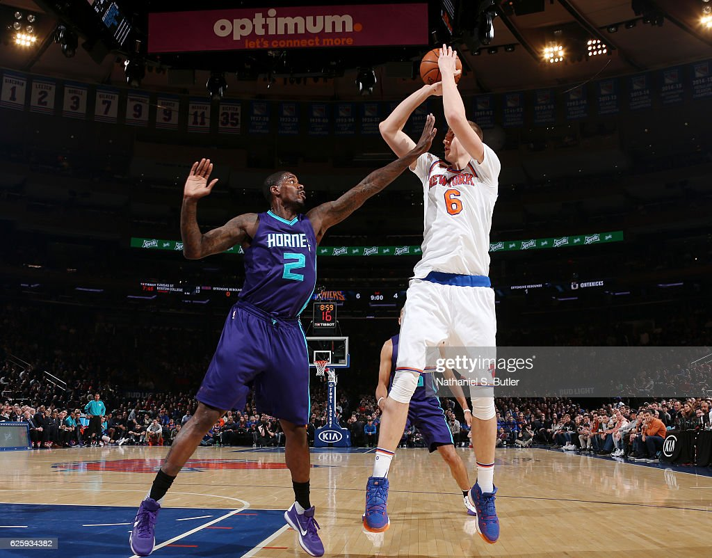 Kristaps Porzingis #6 of the New York Knicks shoots the ball while defended by Marvin Williams #2 of the Charlotte Hornets at Madison Square Garden in New York, New York.