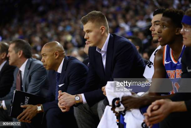 Kristaps Porzingis of the New York Knicks sits on the bench during their game against the Golden State Warriors at ORACLE Arena on January 23 2018 in...