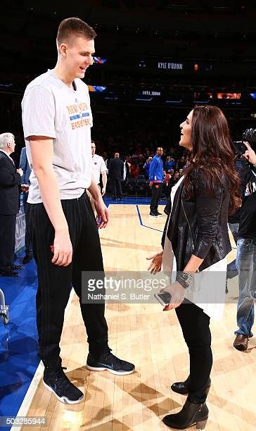 Kristaps Porzingis of the New York Knicks speaks with Bollywood actress Neha Dhupia before the game against the Atlanta Hawks on January 3, 2016 at...