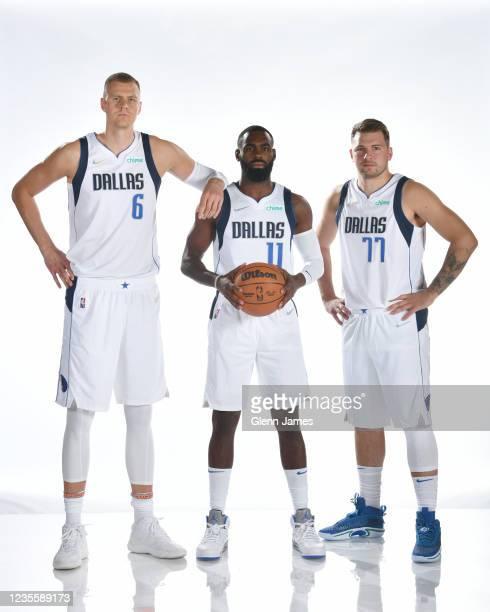 Kristaps Porzingis, Tim Hardaway Jr. #11 and Luka Doncic of the Dallas Mavericks pose for a portrait during NBA media Day on September 28, 2021 at...