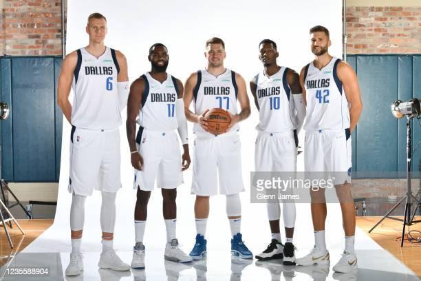 Kristaps Porzingis, Tim Hardaway Jr. #11, Luka Doncic, Dorian Finney-Smith and Maxi Kleber of the Dallas Mavericks poses for a portrait during NBA...
