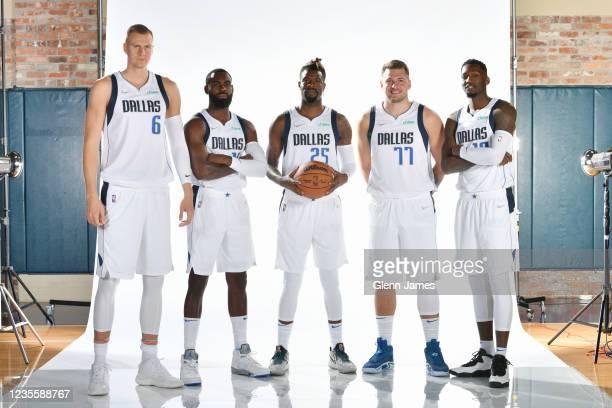 Kristaps Porzingis, Tim Hardaway Jr. #11, Reggie Bullock, Luka Doncic, and Dorian Finney-Smith of the Dallas Mavericks pose for a portrait during NBA...