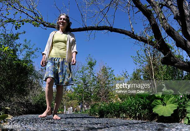 Kriste Brushaber takes a walk through the Denver Botanic Gardens in her bare feet making sure to walk dirt paths and the reflexology path