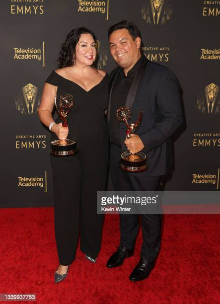 """Kristen Anderson-Lopez and Robert Lopez pose with the award for Outstanding Original Music and Lyrics for """"WandaVision"""" at the Creative Arts Emmys at..."""
