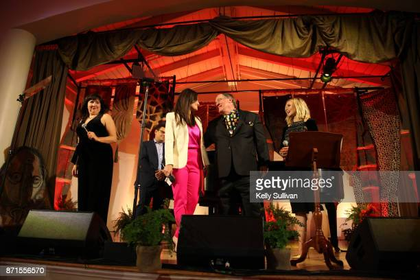 Kristen AndersonLopez Bobby Lopez Idina Menzel and Kristen Bell perform You've Got a Friend In Me onstage with John Lasseter recipient of the Diane...