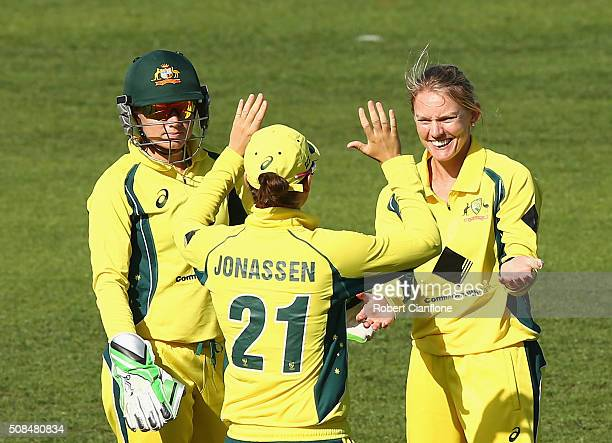 Kristen Beams of Australia celebrates after taking the wicket of Veda Krishnamurthy of India during game two of the women's one day international...