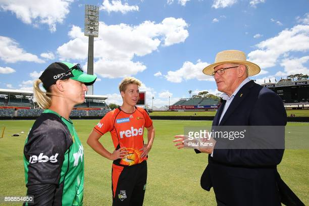 Kristen Beams of the Stars and Elyse Villani of the Scorchers talk with match referee Ian Thomas following the coin toss during the Women's Big Bash...