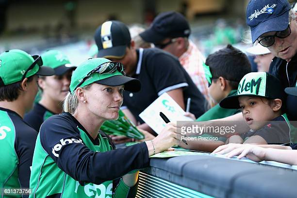Kristen Beams of the Stars signs autographs during the Women's Big Bash League match between the Melbourne Stars and the Adelaide Strikers at...