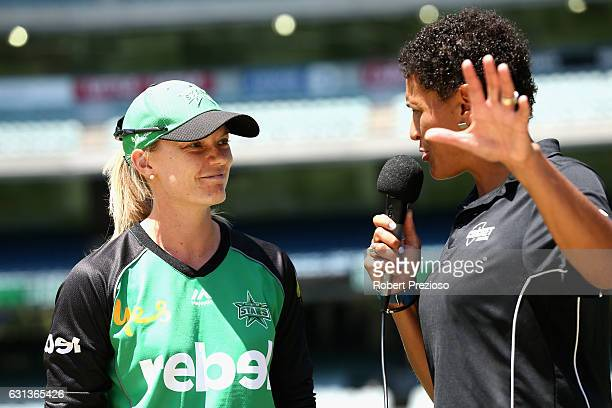 Kristen Beams of the Stars speaks after completing the coin toss during the Women's Big Bash League match between the Melbourne Stars and the...