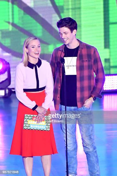 Kristen Bell and Grant Gustin onstage at Nickelodeon's 2018 Kids' Choice Awards at The Forum on March 24 2018 in Inglewood California