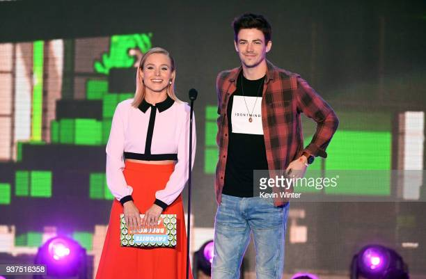 Kristen Bell and Grant Gustin speak onstage at Nickelodeon's 2018 Kids' Choice Awards at The Forum on March 24 2018 in Inglewood California