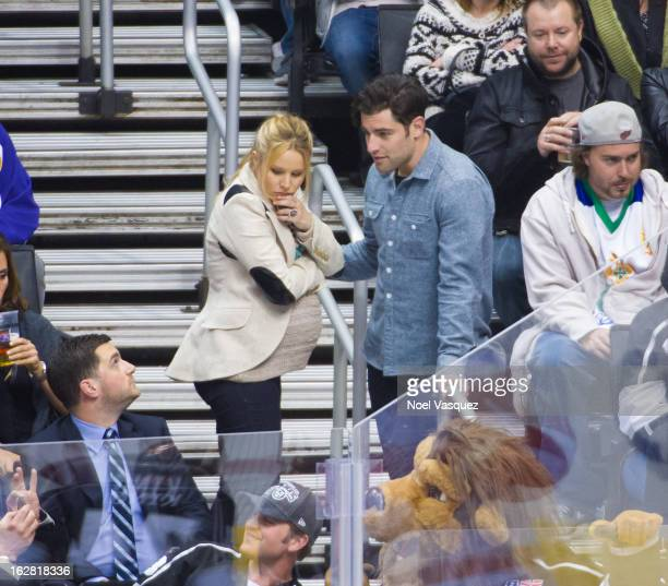 Kristen Bell and Max Greenfield attend a hockey game between the Detroit Red Wings and Los Angeles Kings at Staples Center on February 27 2013 in Los...