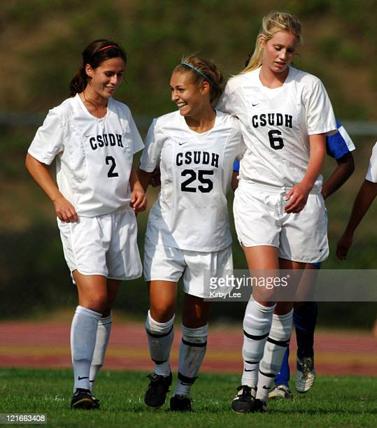 Kristen Boskovich of Cal State Dominguez Hills is congratulated by Sandra Lloyd and Tara Senff after scoring the winning goal in 21 overtime victory...