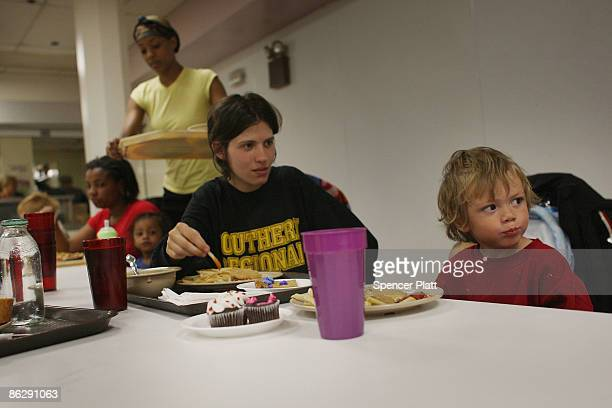 Kristen Buckley and her son Thomas eat lunch in the dining area at the Atlantic City Mission a nonprofit Christian social service ministry that...