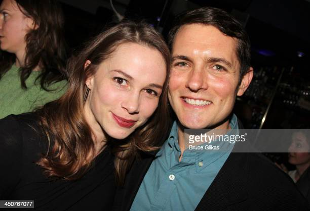 Kristen Bush and Zach Shaeffer pose at the opening night party for Taking Care of Baby at Faces Names Lounge on November 19 2013 in New York City