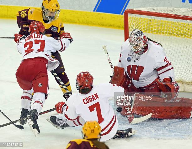 Kristen Campbell of the Wisconsin Badgers makes the save as Grace Bowlby pushes Sarah Potomak of the Minnesota Golden Gophers as Sam Cogan goes down...