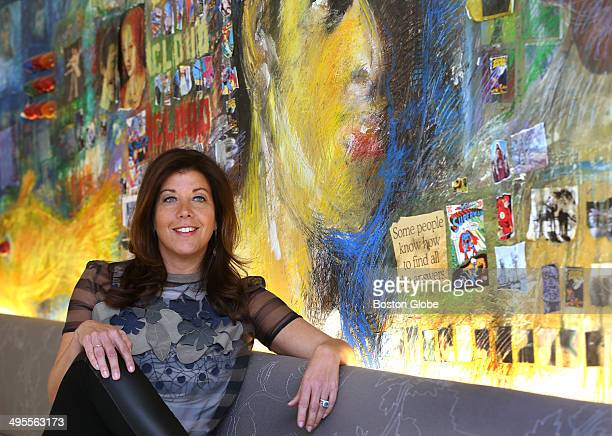 """Kristen Cavallo has been promoted to president of the Boston advertising agency, Mullen. She is photographed in the cafe next to the mural """"Unbound,""""..."""