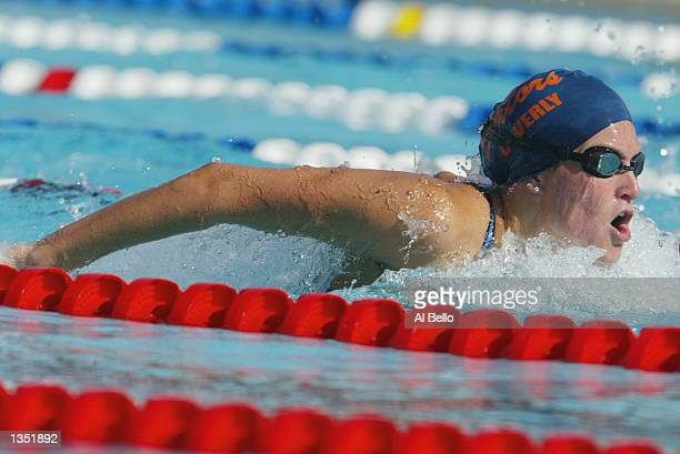 Kristen Caverly competes in the 400m individual medley during a preliminary heat of the Phillips 66 National Swimming Championships at the Hall of...