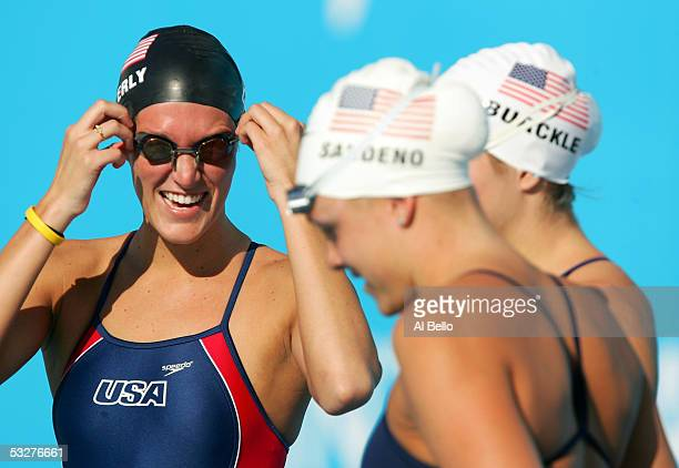 Kristen Caverly Kaitlin Sandeno and Caroline Burckle of the United States share a laugh before getting in the water for a training session before the...