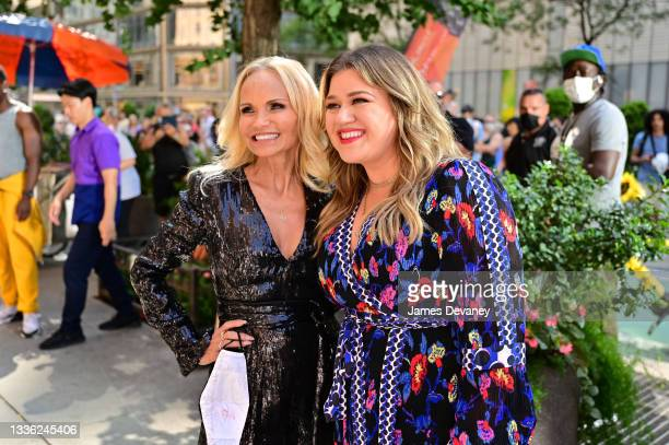 Kristen Chenoweth and Kelly Clarkson seen during a music video in Columbus Circle on August 24, 2021 in New York City.