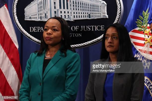 Kristen Clarke, Assistant Attorney General for the Civil Rights Division, and Vanita Gupta, associate U.S. Attorney general, listen as Attorney...