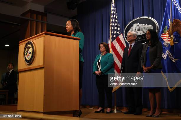 Kristen Clarke, Assistant Attorney General for the Civil Rights Division speaks at a news conference, as Lisa O. Monaco, Deputy Attorney General,...