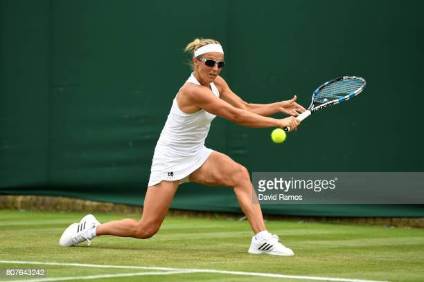 Kristen Flipkins of Belgium plays a forehand during the Ladies Singles first round match against Misaki Doi of Japan on day two of the Wimbledon Lawn...