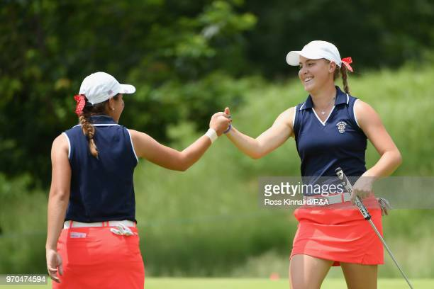 Kristen Gillman and Jennifer Kupcho of the United States team celebrate a putt for birdie on the 15th green as they play against Olivia Mehaffey and...