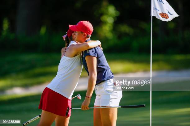 Kristen Gillman of Alabama and Gigi Stoll of Arizona hug after the completion of their match during the Division I Women's Golf Team Match Play...