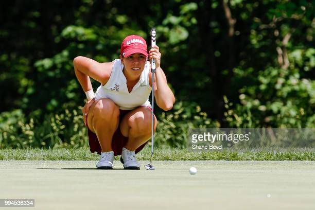 Kristen Gillman of Alabama lines a putt during the Division I Women's Golf Team Match Play Championship held at the Karsten Creek Golf Club on May 23...
