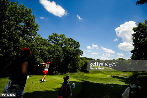 Kristen Gillman of Alabama tees off as Gigi Stoll of Arizona watches during the Division I Women's Golf Team Match Play Championship held at the...