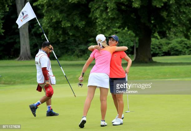 Kristen Gillman of the United States finishes her match against Annabell Fuller of the Great Britain and Ireland team on the 14th green sealing a 50...