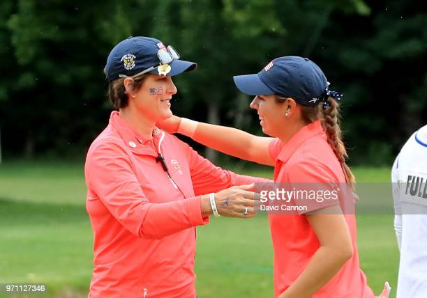 Kristen Gillman of the United States is congratulted by her captain Virginia Derby Grimes after Gillman had won her match against Annabell Fuller of...