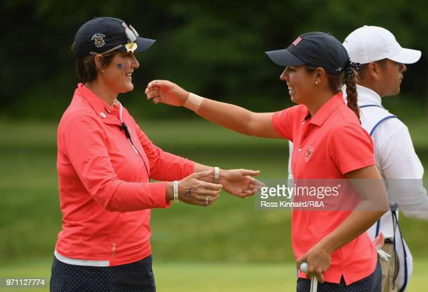 Kristen Gillman of the United States team and Captain Virginia Derby Grimes celebrate a matchwinning point on the 14th green during the singles...