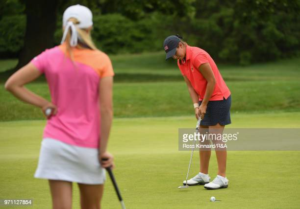 Kristen Gillman of the United States team plays a matchwinning putt on the 14th green as Annabell Fuller of the Great Britain and Ireland team looks...