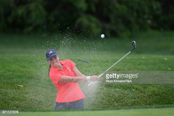 Kristen Gillman of the United States team plays a shot from a bunker on the 14th hole during the singles matches on day three of the 2018 Curtis Cup...