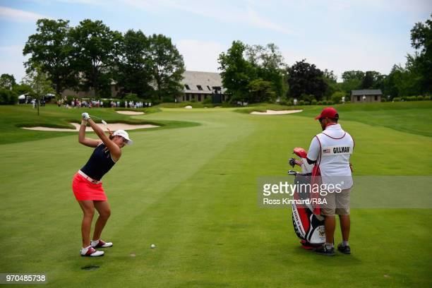 Kristen Gillman of the United States team plays her second shot on the 16th hole in her match with Jennifer Kupcho against Olivia Mehaffey and Sophie...