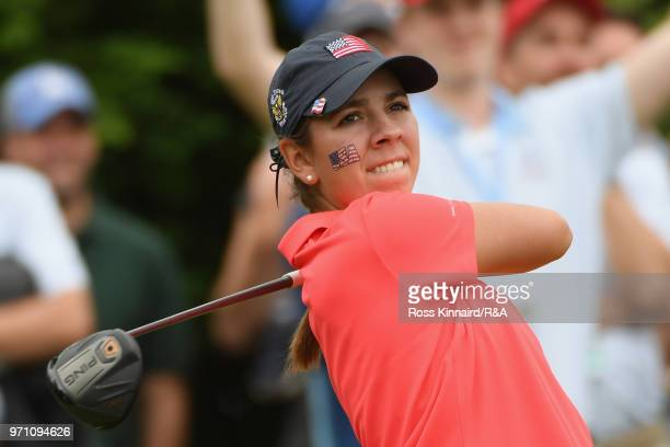 Kristen Gillman of the United States team plays her shot from the first tee during the singles matches on day three of the 2018 Curtis Cup Match at...