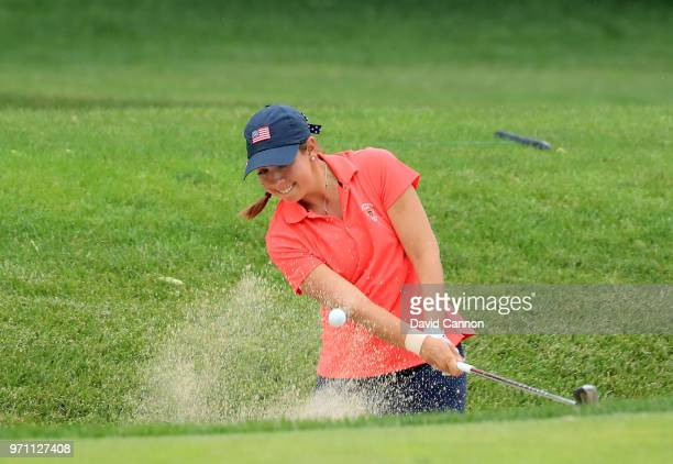 Kristen Gillman of the United States team plays her third shot on the 14th hole in her match against Annabell Fuller of the Great Britain and Ireland...