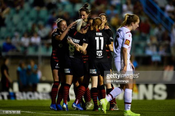 Kristen Hamilton of the Wanderers celebrates scoring a goal with team mates during the round 1 W-League match between the Western Sydney Wanderers...