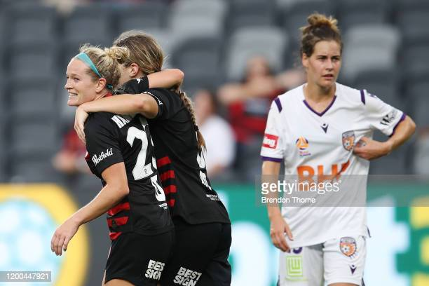 Kristen Hamilton of the Wanderers celebrates scoring a goal with team mates during the round 10 W-League match between the Western Sydney Wanderers...