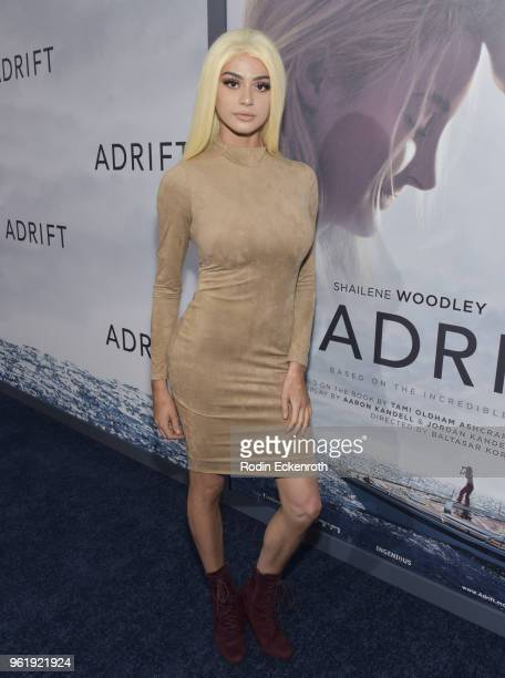Kristen Hancher arrives at the premiere of STX Films' 'Adrift' at Regal LA Live Stadium 14 on May 23 2018 in Los Angeles California