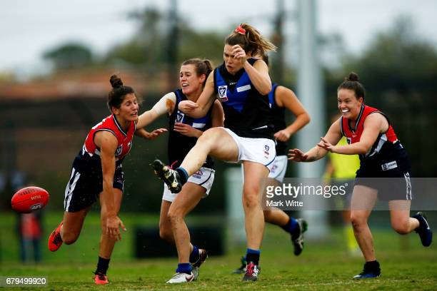 Kristen Hay of Melbourne Uni kicks the ball during the round one VFL Women's match between the Darebin Falcons and Melbourne Uni at Bill Lawry on May...