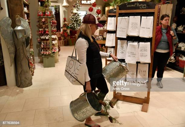 Kristen Johnson holds two tin buckets while waiting in the checkout line at the Cozy Cottage store in the Cherry Creek Mall November 22 2017 Cozy...