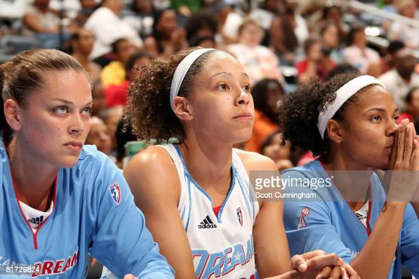Kristen Mann Jennifer Lacy and Chioma Nnamaka of the Atlanta Dream watch the action from the bench during the WNBA game against the Chicago Sky on...