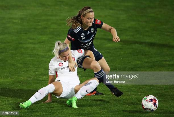 Kristen McNabb of the Victory and Erica Halloway of the Wanderers compete for the ball during the round eight WLeague match between the Melbourne...