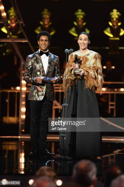 Kristen McNally and Marcelino Sambe accept the award for Best New Dance Production for 'Flight Pattern' on stage during The Olivier Awards with...