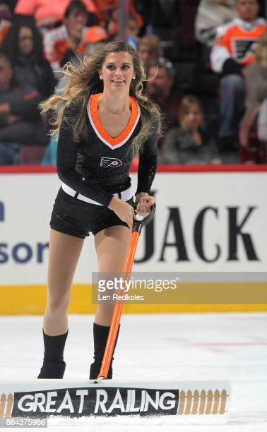 Kristen Mee of the Philadelphia Flyers ice girls cleans the ice during a timeout against the Florida Panthers on October 17 2017 at the Wells Fargo...