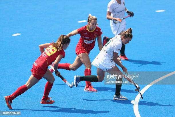 Kristen Paton of South Africa gets past Lucia Jimenez of Spain and Maria Lopez of Spain during the Pool C game between Spain and South Africa of the...