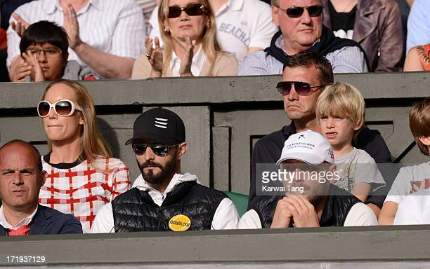 Kristen Pazik and Andriy Schevchenko attend the Novak Djokovic vs Jeremy Chardy match on Day 6 of the Wimbledon Lawn Tennis Championships at the All...